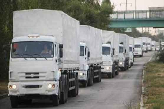 Tired of waiting, Russia pushes aid into Ukraine