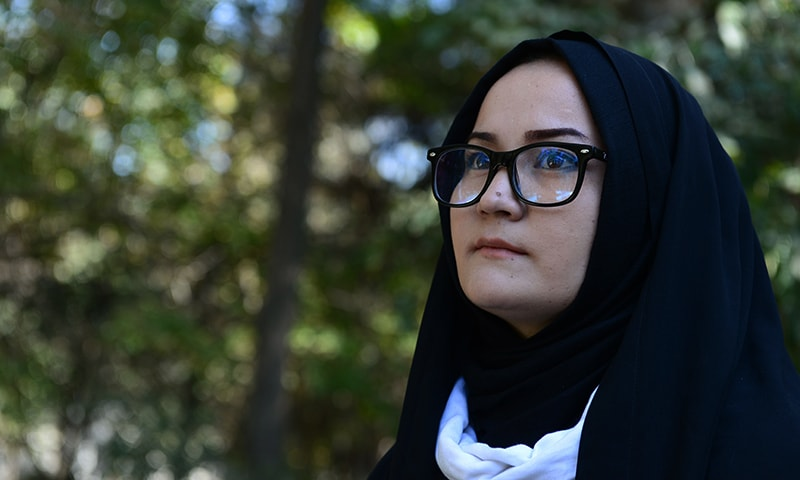 To go with 'Afghanistan-unrest-women-Taliban' by Guillame Decamme In this photograph taken on October 29, 2015, Afghan psychologist Fatima Sadat Alawi ,23, looks on during an interview with AFP at Wazir Akbar Khan Park in Kabul. Halfway through the journey home to Kabul, a Taliban militant stopped Fatima's bus, boarded, and began making a speech so extraordinary that the 23-year-old began to surreptitiously film it on her phone. AFP PHOTO / AREF KARIMI