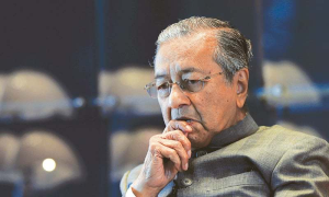 Malaysian police question former PM Mahathir Mohamad