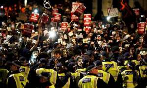 Violence as anti-capitalist march hits London