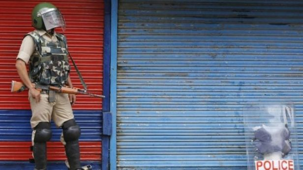 India Kashmir dispute Newspapers raided by police