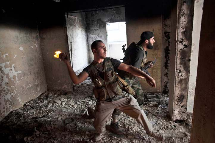 Free Syrian Army soldiers throws a petrol bomb against Syrian Army positions in Saif Al Dawle district in Aleppo, Syria, Wednesday, Oct. 3, 2012. (AP Photo /Manu Brabo, File)