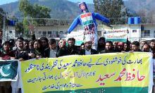 protesters-demand-release-of-hafiz-saeed-set-trump-modi-effigy-on-fire